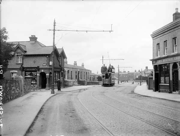 """Irishtown Road."" The photograph was published between 1890 and 1910 and is part of the Lawrence Photograph Collection available online at the National Library of Ireland."