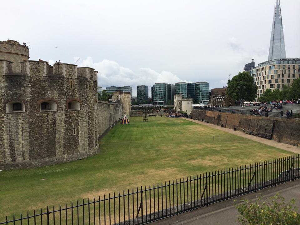 The moat at the Tower of London juxtaposed with modern architecture. Photo by Jasmine Mulliken, June 2014.