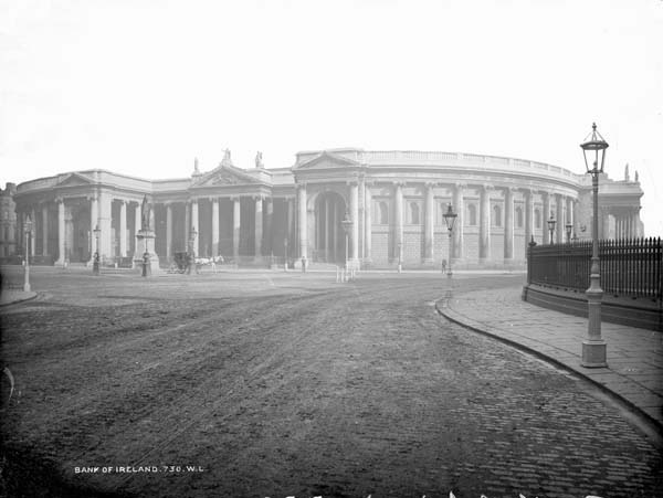 Bank of Ireland, at the corner of Dame Street and Westmoreland Street. Just to the right, not pictured) is Trinity College. Photographed by Robert French between 1880 and 1900. From the Lawrence Photograph Collection at the National Library of Ireland.