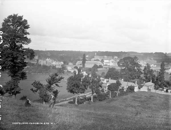 """""""Chapelizod, Co. Dublin,"""" showing a view of the village, looking south from the hill above. This view is more romantic than the one above, perhaps even Wordsworthean ala """"Tintern Abbey."""" Recall that Mr. Duffy keeps his Wordsworth on the bottom shelf of his bookcase."""