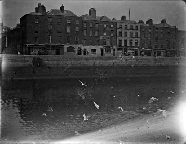 """[View of the River Liffey and Ormond Quay, Lower, taken from south quays]."" Photograph by J.J. Clarke. From the Clarke Photographic Collection at the National Library of Ireland."