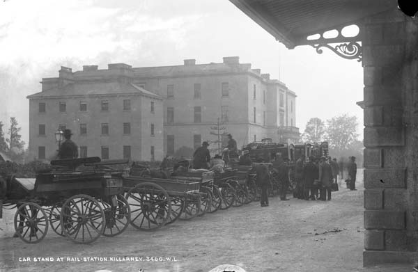 """Railway Station Cab-stand, Killarney, Co. Kerry."" This photo, from the digitized Lawrence Photograph Collection at the National Library of Ireland, shows typical late-nineteenth-, early-twentieth-century carriages like the one Father Flynn and his sisters might have rented or that Gabriel and Gretta would have hired to take them to the Gresham."