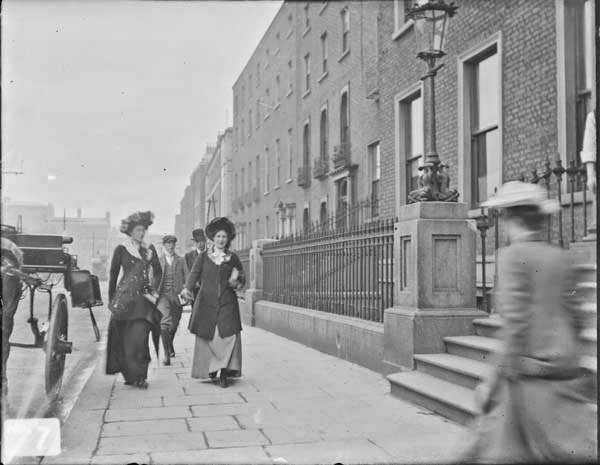 Photo, ca. 1890-1910, of people walking down what appears to be the east side of Stephen's Green, just south of the Hume Street corner where Corley's girl would be waiting.