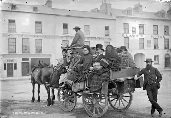 "Galway Mail Car, photographed by Robert French between 1880 and 1900. The carriage pictured is a mail car, or ""Bian,"" used for public transportation in the 19th century. Reproduced in the Irish Times article ""Charles Bianconi and the 'Ryanair of the 19th century'."""