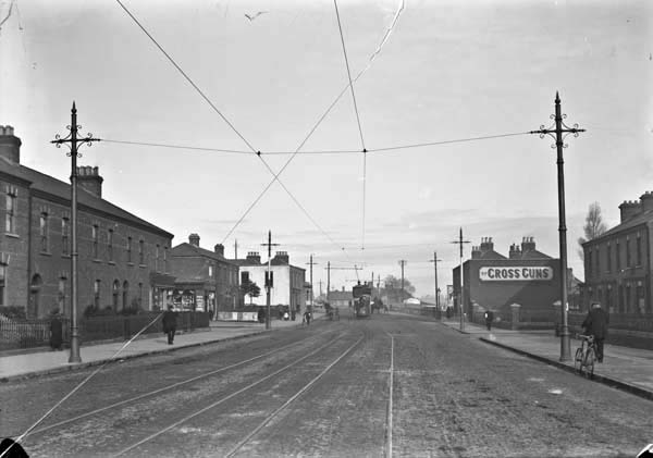 "Photograph of Phibsborough Road at Crossguns Bridge, published between 1900 and 1939. Using the route describes more explicitly in Ulysses and the 1883 map of Dublin, this is a possible vicinity of Kernan's residence in ""the Glasnevin road."""