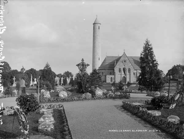 Parnell's Grave at Glasnevin Cemetry. The tower in the background is the O'Connell Monument. Photo by Robert French, between 1891 and 1900. From the National Library of Ireland's digitized Lawrence Photograph Collection.
